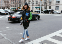 Elaine Welteroth in a Moschino jacket and Nike shoes NYFW Fall 2017 by Phil Oh